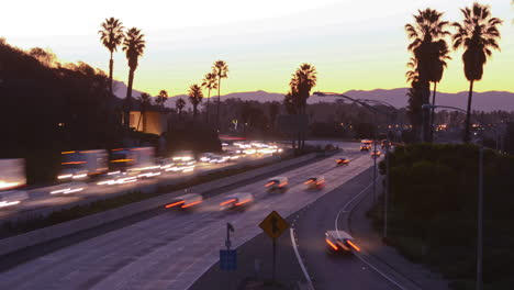 Time-lapse-cars-travel-on-a-freeway-at-sunset-or-dusk-1