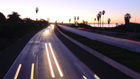 Time-lapse-cars-travel-on-a-freeway-at-sunset-or-dusk-2