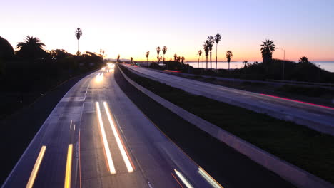 Time-lapse-cars-travel-on-a-freeway-at-sunset-or-dusk-3