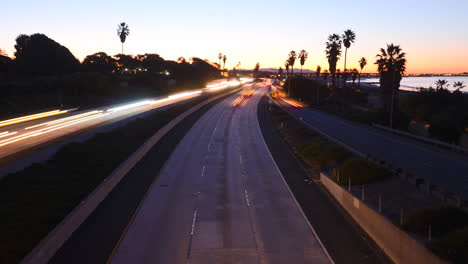 Time-lapse-cars-travel-on-a-freeway-at-sunset-or-dusk-4