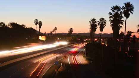 Time-lapse-cars-travel-on-a-freeway-at-sunset-or-dusk-5