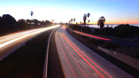 Time-lapse-cars-travel-on-a-freeway-at-sunset-or-dusk-6
