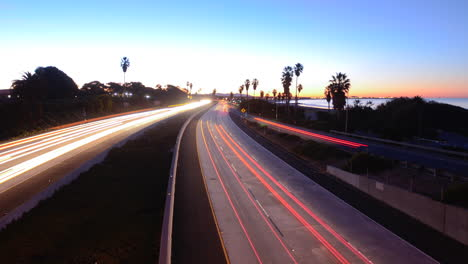 Time-lapse-cars-travel-on-a-freeway-at-sunset-or-dusk-7