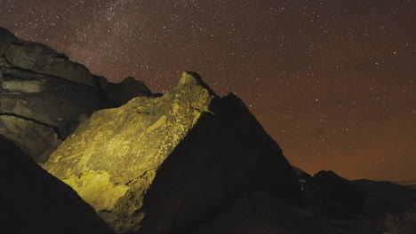 Dolly-shot-time-lapse-at-night-of-a-sacred-Owens-Valley-Paiute-petroglyph-site-in-the-Eastern-Sierras-California-2