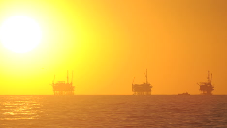 Day-to-night-time-lapse-of-the-sun-setting-behind-three-oil-platforms-in-the-Santa-Barbara-Channel-California