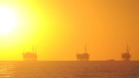 Day-to-night-time-lapse-of-the-sun-setting-behind-three-oil-platforms-in-the-Santa-Barbara-Channel-California-1