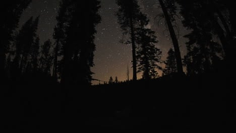 Motion-night-time-lapse-of-the-milky-way-and-stars-above-a-campfire-at-Sardine-Lake-Campground-in-Sierra-Buttes-California