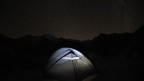 Dolly-shot-of-a-tent-and-star-trail-time-lapse-below-Mount-Whitney-in-the-Sierra-Nevada-Mountains-near-Lone-Pine-California