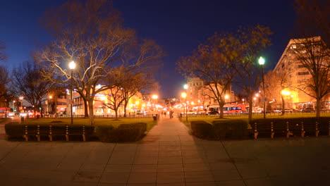 Wide-motion-time-lapse-of-people-walking-during-rush-hour-traffic-at-dusk-in-Dupont-Circle-in-Washington-DC-1