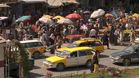 Taxis-and-vehicle-traffic-near-a-busy-fruit-market-in-Kabul-Afghanistan