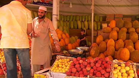 A-man-shops-in-a-fruit-market-in-Kabul-Afghanistan