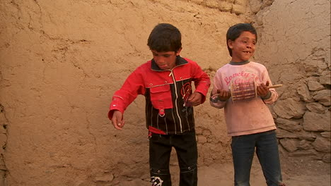 A-blind-child-and-friend-play-with-broken-kites-in-Kabul-Afghanistan
