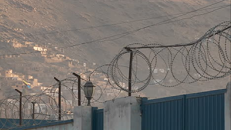 Razor-wire-and-kites-flying-against-a-hillside-in-Kabul-Afghanistan