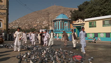 Pigeons-fly-in-front-of-the-Shahe-Do-Shamshera-Mosque-in-Kabul-Afghanistan-1