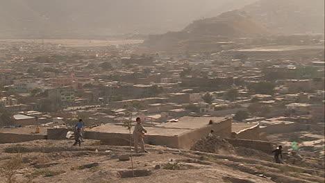Boys-play-on-the-hillsides-flying-kites-in-modern-Kabul-Afghanistan