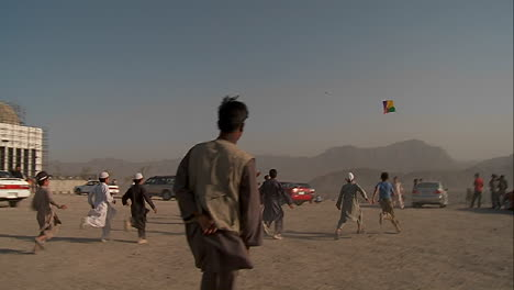 Kids-chase-and-play-with-kites-in-an-empty-lot-in-kabul-Afghanistan