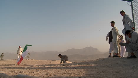 Kids-chase-and-play-with-kites-in-an-empty-lot-in-kabul-Afghanistan-1