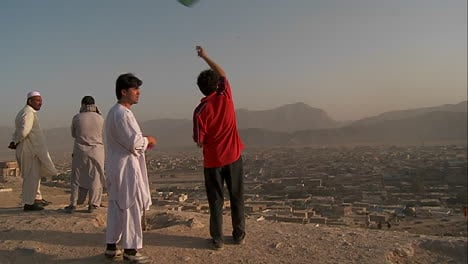 Men-fly-kites-on-a-hill-overlooking-Kabul-Afghanistan