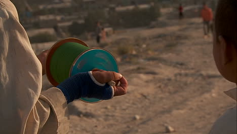 Kids-fly-kites-on-a-giant-spool-on-a-hill-overlooking-Kabul-Afghanistan