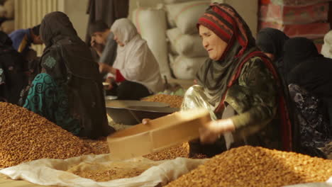 Women-work-in-a-factory-in-Afghanistan-producing-and-packaging-dried-almonds-5