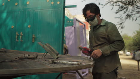 A-worked-does-spot-welding-in-an-outdoor-metal-shop-in-Afghanistan