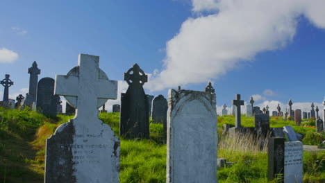 Nice-timelapse-of-clouds-moving-over-old-headstones-in-a-cemetery-or-graveyard