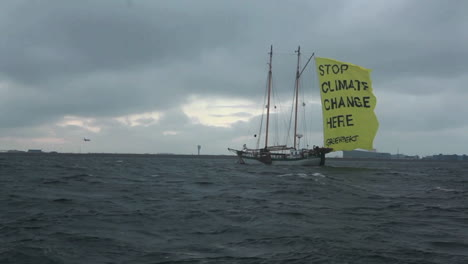 A-ship-with-a-flag-proclaims-an-end-to-global-warming