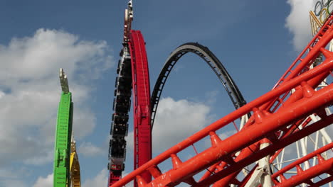 A-roller-coaster-goes-around-a-looping-track-at-an-amusement-park