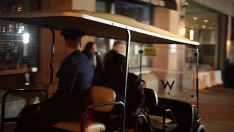 Dr-Ben-Carson-is-transported-via-golf-cart-through-the-streets-of-Washington-DC