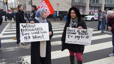Protestors-hold-up-humorous-signs-in-an-antiTrump-rally-in-Washington-DC