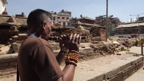 A-monk-walks-through-the-ruins-of-Kathmandu-following-the-earthquake-in-Nepal-in-April-2015