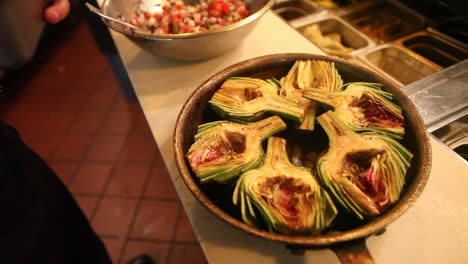 An-entree-of-artichokes-is-presented-ion-a-bowl