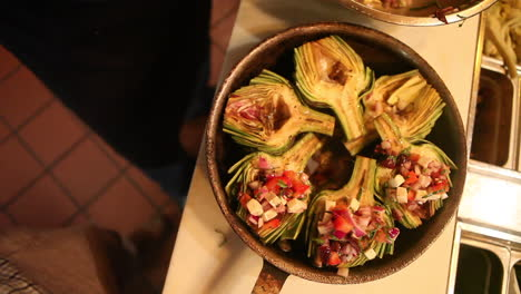 An-entree-of-artichokes-is-presented-ion-a-bowl-1