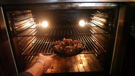 A-fresh-pizza-is-placed-in-an-oven