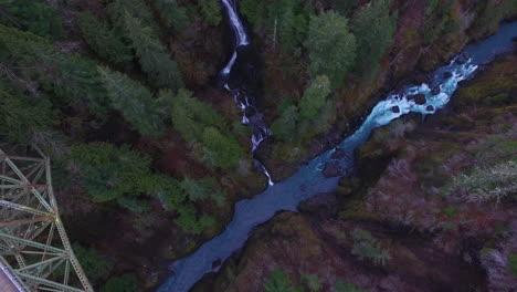 An-aerial-over-a-steel-suspension-bridge-over-the-Skokomish-River-in-Washington-USA