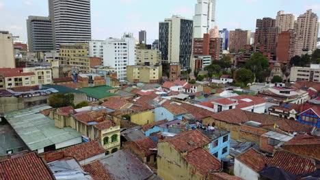 Beautiful-aerial-establishing-shot-of-old-buildings-modern-skyscrapers-and-neighborhoods-in-downtown-Bogota-Colombia