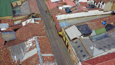 Aerial-establishing-shot-looking-down-of-a-red-tile-roofed-neighborhood-in-Bogota-Colombia
