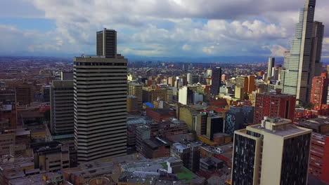 Beautiful-rising-aerial-establishing-shot-of-old-buildings-modern-skyscrapers-and-neighborhoods-in-downtown-Bogota-Colombia