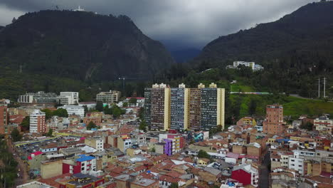 Lowering-aerial-establishing-shot-of-old-buildings-modern-skyscrapers-and-neighborhoods-in-downtown-Bogota-Colombia