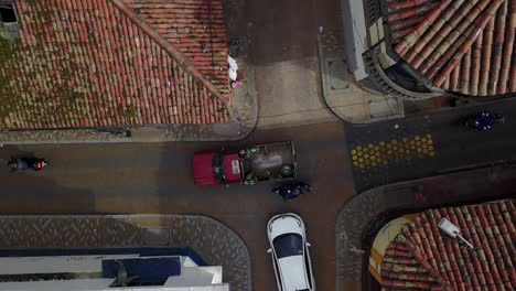 Aerial-establishing-shot-looking-straight-down-of-a-red-tile-roofed-neighborhood-and-streets-in-Bogota-Colombia-1
