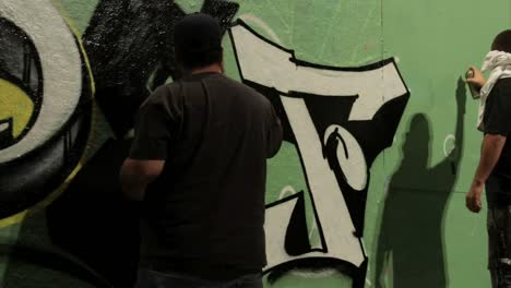Time-lapse-shot-of-graffiti-being-sprayed-on-a-wall-by-taggers-1