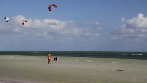 People-engage-in-the-fast-moving-sport-kite-boarding-along-a-sunny-coast-1