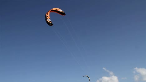 People-engage-in-the-fast-moving-sport-kite-boarding-along-a-sunny-coast-4