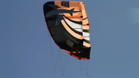 People-engage-in-the-fast-moving-sport-kite-boarding-along-a-sunny-coast-5