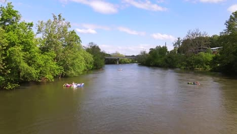 An-Excellent-Aerial-Shot-Of-Tourists-Floating-Down-The-French-Broad-River-In-Asheville-North-Carolina