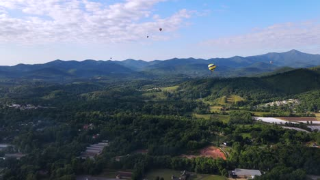 An-Excellent-Aerial-Shot-Of-Hot-Air-Balloons-Flying-Over-Asheville-North-Carolina