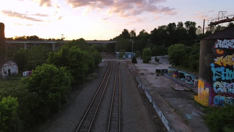 An-Excellent-Aerial-Shot-Of-Railroad-Tracks-Headed-Towards-A-Bridge-In-Asheville-North-Carolina