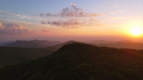 An-Excellent-180-Aerial-Shot-Of-The-Sun-Rising-Over-The-Blue-Ridge-Mountains-In-North-Carolina