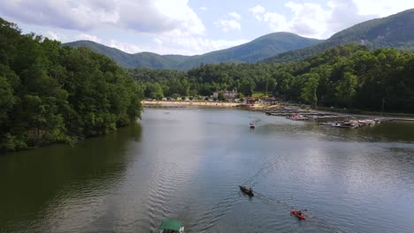An-Excellent-Aerial-Shot-Of-Kayaks-And-Other-Vessels-On-Lake-Lure-In-Chimney-Rock-North-Carolina