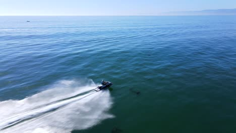 An-Excellent-Aerial-Shot-Of-A-Man-Jet-Skiing-On-Clear-Water